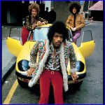 Picture of Jimi Hendrix on the hood of a Lotus Elan.