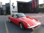 The 1972 Lotus Elan Plus 2S/130 in front of the Ferrari Museum.